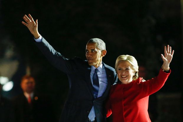 Democratic presidential nominee Hillary Clinton and US President Barack Obama wave from the stage during an election campaign rally on November 7, 2016 in Philadelphia. About 40,000 people flooded Independence Mall in Philadelphia for Hillary Clinton's rally with her husband Bill, President Barack Obama and his wife Michelle at her side, a campaign aide said. The attendance set a new record for Clinton, with the previous high point a rally in Ohio that drew 18,500 people, a campaign aide told reporters traveling with the candidate.