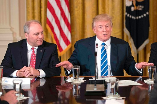 (FILES) This file photo taken on March 7, 2017 shows US President Donald Trump (R) speaking with US Congressman and Majority Whip Steve Scalise (L), R-Louisiana, during a meeting with the US House Deputy Whip team at the White House in Washington, DC. Senior Republican Congressman Steve Scalise was among several victims shot and wounded at a baseball practice ahead of an annual game between lawmakers in a Washington suburb, one of his colleagues said June 14, 2017.Fellow Republican lawmaker Mo Brooks told CNN that Scalise was shot in the hip, adding that at least two law enforcement officers and one congressional staffer were shot in Alexandria, Virginia. / AFP PHOTO / JIM WATSON ORG XMIT: JIM021