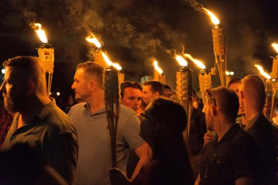White nationalists carry torches around a statue of Thomas Jefferson on the grounds of the University of Virginia, on the eve of a planned Unite The Right rally in Charlottesville, Virginia, U.S. August 11, 2017. Picture taken August 11, 2017. Alejandro Alvarez/News2Share via REUTERS. MANDATORY CREDIT. NO RESALES. NO ARCHIVES ORG XMIT: TOR500