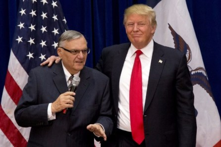 """FILE - In this Jan. 26, 2016 file photo, then-Republican presidential candidate Donald Trump is joined by Joe Arpaio, the sheriff of metro Phoenix, at a campaign event in Marshalltown, Iowa. President Donald Trump has pardoned former sheriff Joe Arpaio following his conviction for intentionally disobeying a judge's order in an immigration case. The White House announced the move Friday night, Aug. 25, 2017, saying the 85-year-old ex-sheriff of Arizona's Maricopa County was a """"worthy candidate"""" for a presidential pardon. (AP Photo/Mary Altaffer, File) ORG XMIT: NY117"""
