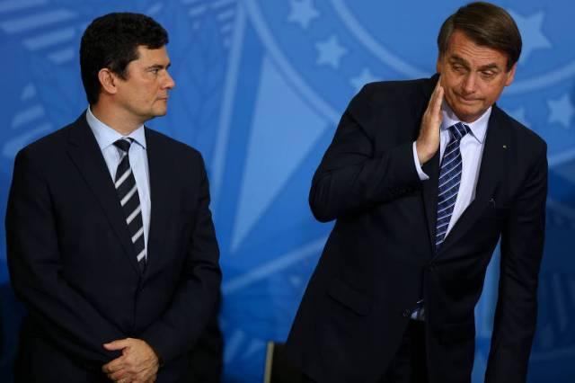 O presidente Jair Bolsonaro ao lado do ex-ministro Sergio Moro (Justiça) em Solenidade de Lançamento do Projeto em Frente Brasil, de medidas para a segurança pública, no Palácio do Planalto, em 2019