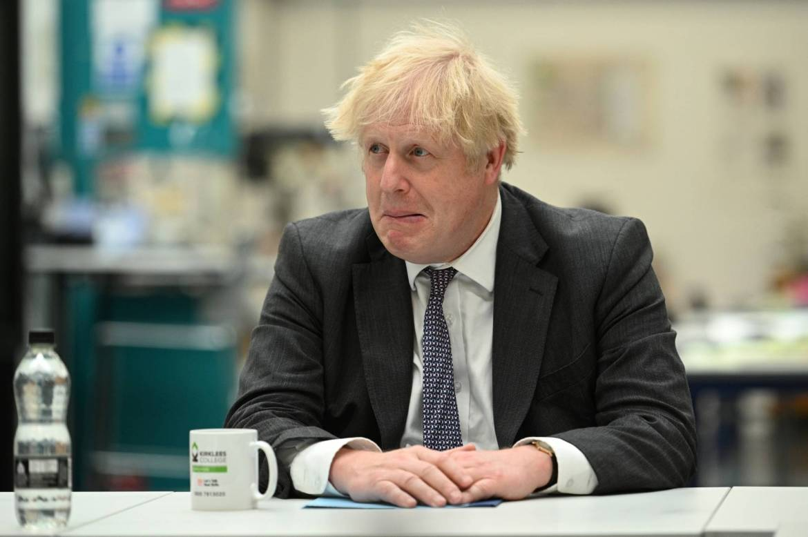 British Prime Minister Boris Johnson chats with teachers at a college in Dewsbury, England, on Friday. | POOL / VIA REUTERS