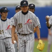Masahiro Tanaka (center) practices with his teammates at Wukesong Sports Center Baseball Field in Beijing during the 2008 Olympics. | REUTERS