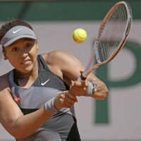 Naomi Osaka, seen during the first round of the French Open in May, will not be competing at Wimbledon this year.  | AP / VIA KYODO