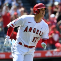 The Angels' Shohei Ohtani begins to round the bases after hitting a two-run home run against the Tigers at Angel Stadium on Sunday.   USA TODAY / VIA REUTERS