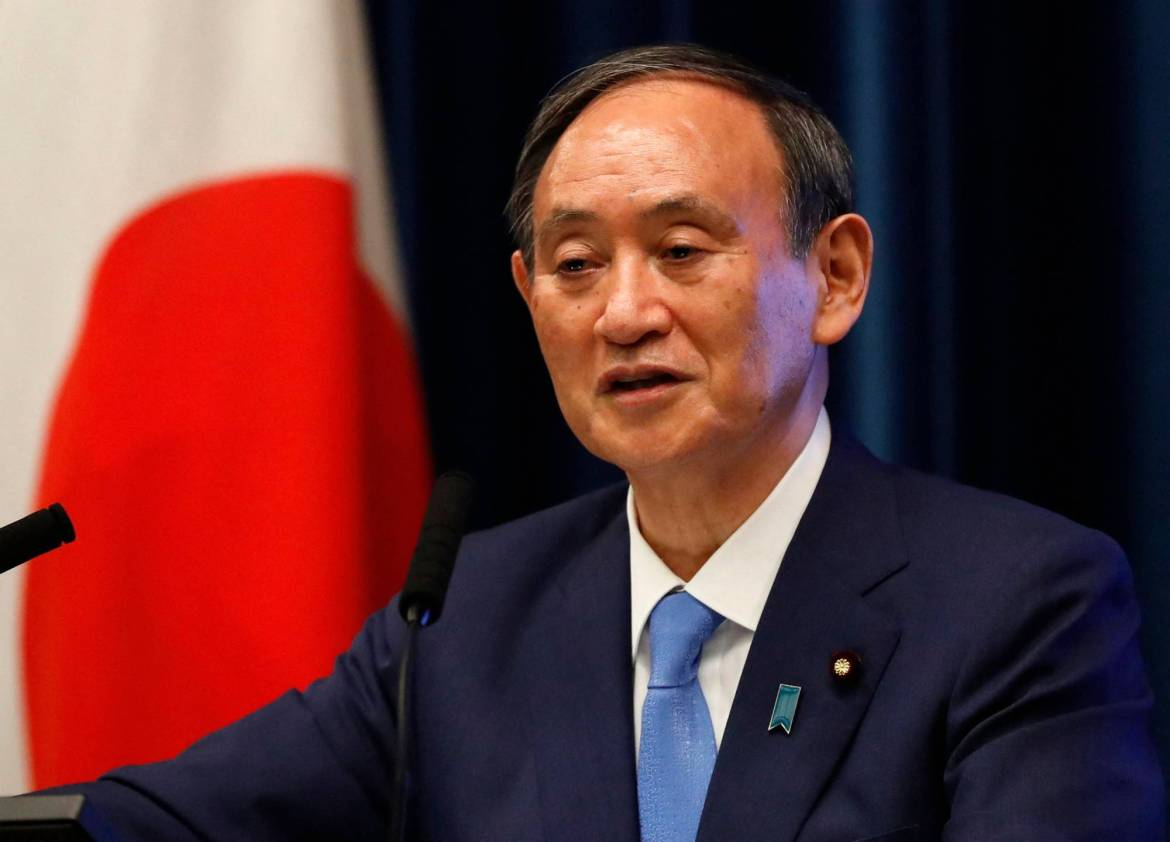 Prime Minister Yoshihide Suga holds a news conference in Tokyo on Thursday. | POOL / VIA AFP-JIJI