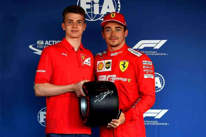 2019 Russian Grand Prix, Saturday - Charles Leclerc receives the   Pirelli Pole Position Award from Robert Shwartzman (image courtesy Scuderia Ferrari Press Office)