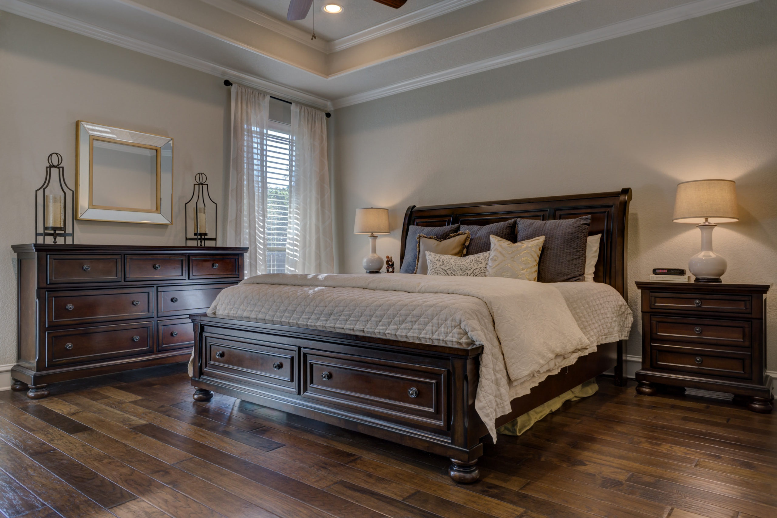 Bedroom with hard wood flooring.