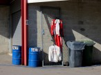 Race suit drying at the back of the support race paddock at the Spa-Francorchamps circuit.
