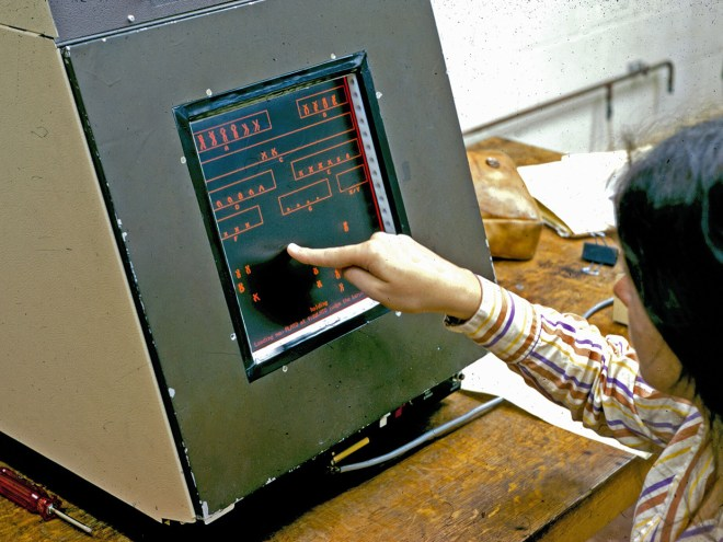 A student using the touch panel during a genetics lesson