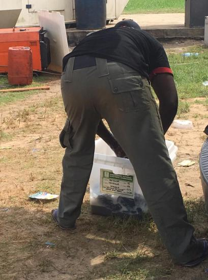 PHOTO: Policeman uses ballot box to wash uniform