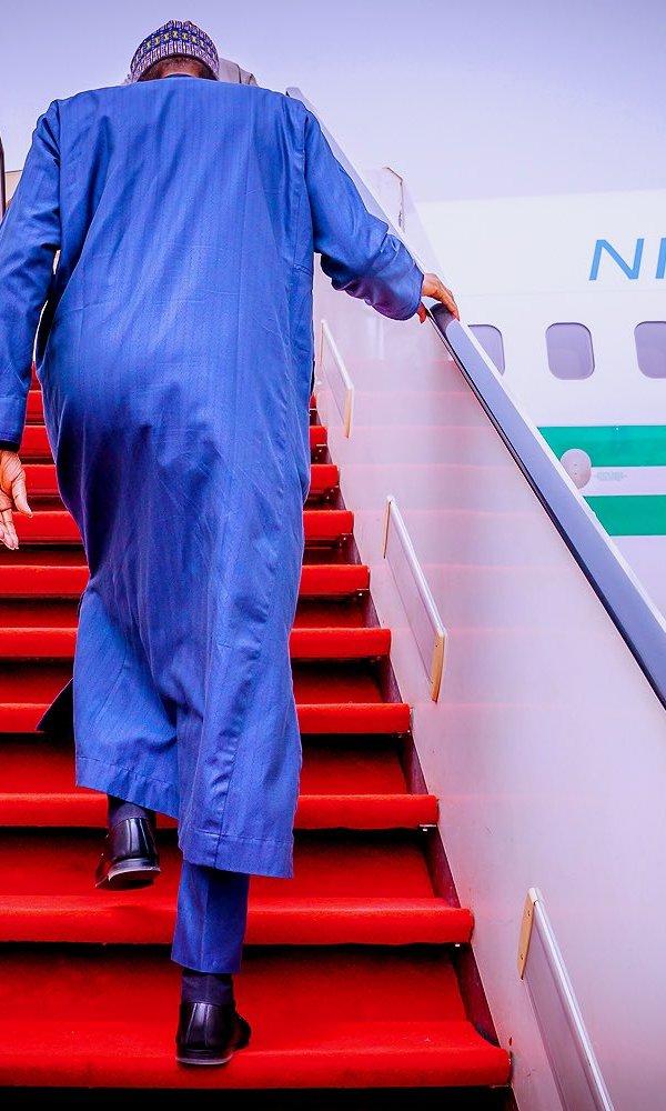 Buhari boards the presidential jet
