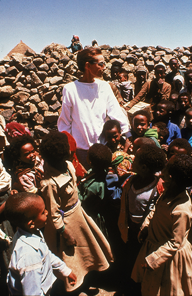 March 1988, Belgian-born actor and UNICEF Special Ambassador Audrey Hepburn (1929 - 1993) stands with children in drought-stricken Ethiopia. (Photo by UNICEF/Getty Images)