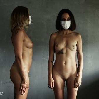 two naked ladies wearing covid-19 mask