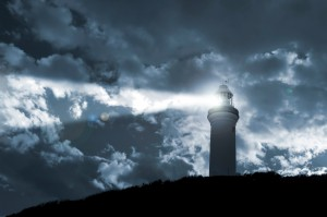 Lighthouse shining in a storm