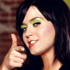 Katy Perry pointing.