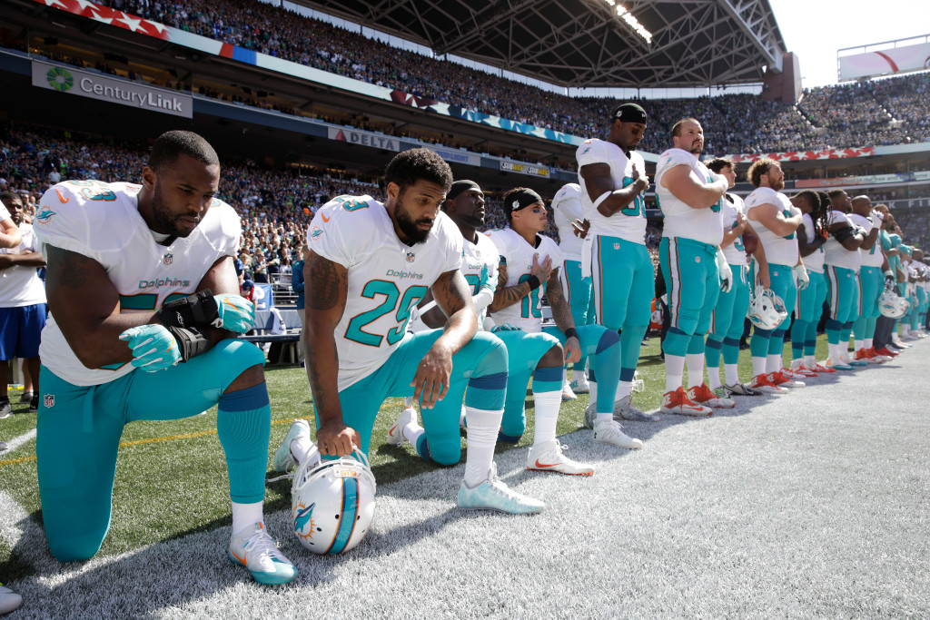 Miami Dolphins kneel during the anthem