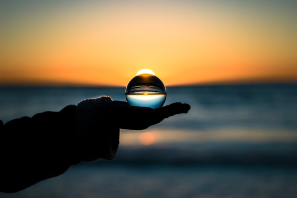 Crystal ball in hand, seeing the world.