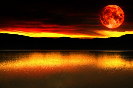 Blood red moon at sunset.