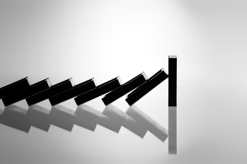 Falling dominoes stopped - dreamstime_16910903