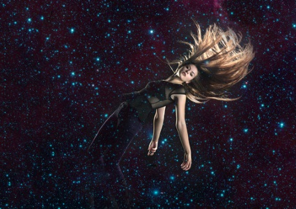 Woman drifting in space