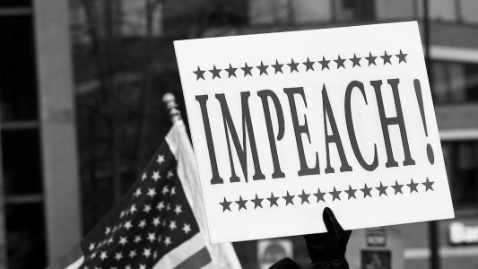 """Impeach"" sign and American flag"