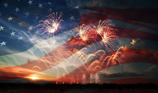Independence day: fireworks over American flag