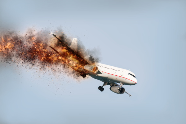 Flying aircraft with burning engine just before it crashes