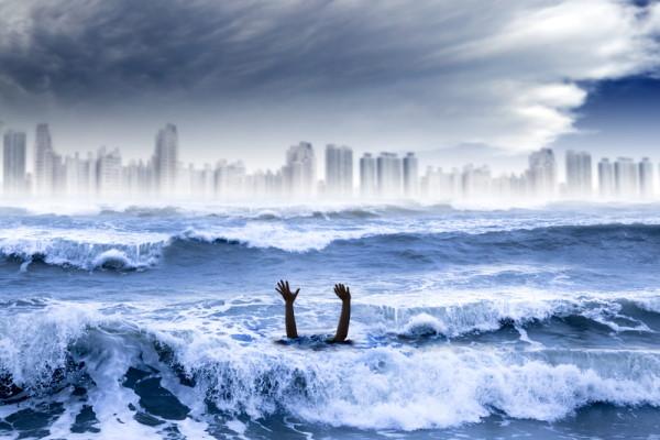 Man drowning in sea - Dreamstime-27423027