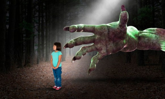 Monster's hand grabbing little girl - Dreamstime-123949643