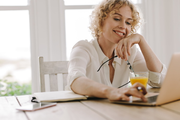 Happy woman working From Home - AdobeStock-224435267
