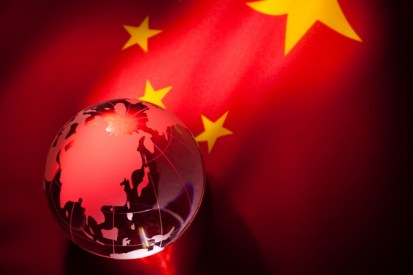 A globe on a China Flag