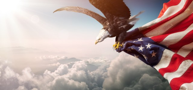 Eagle carrying off an American Flag - AdobeStock-268033806