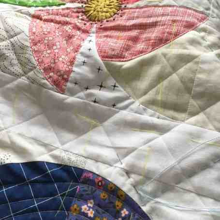 Essential Tools for a quilter: flowers meadow cushion with quilting lines drawn with a Hera Marker by fabricandflowers