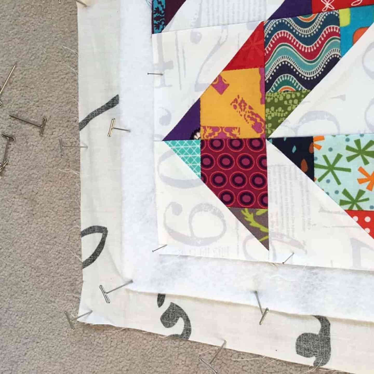 How to baste a quilt on a carpet by fabricandflowers