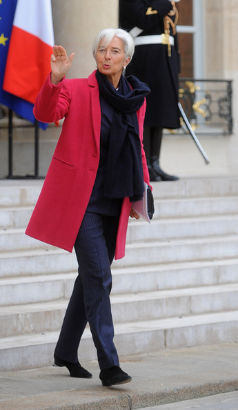 Dark navy trousers, woolen scarf and shoes with red jacket