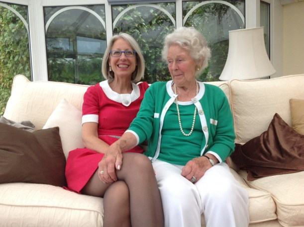 Margaret Barlow and Kate Davies in green and red with white trim