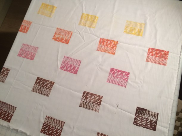 White fabric lino printed with brown, pink and yellow