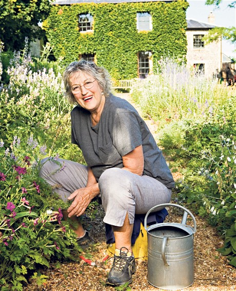 Germaine Greer sitting in her garden