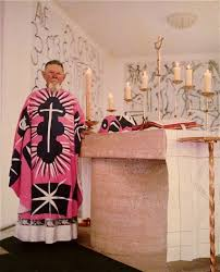 Priest in pink and black vestment designed by Matisse