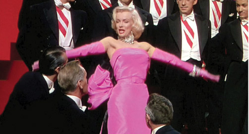 Marilyn Munroe in fitted pink dress