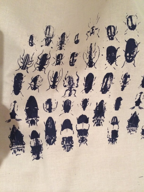 Navy blue bugs on cotton