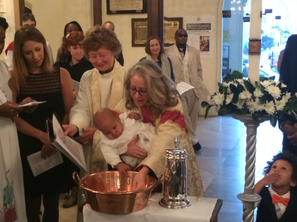 Baby being baptised