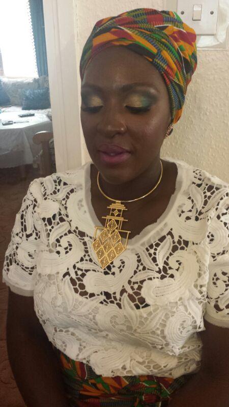Girl in headwrap (Ghana)