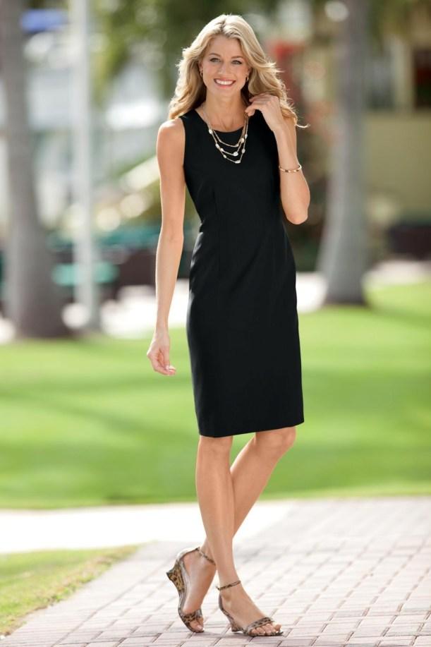 woman in black sheath dress
