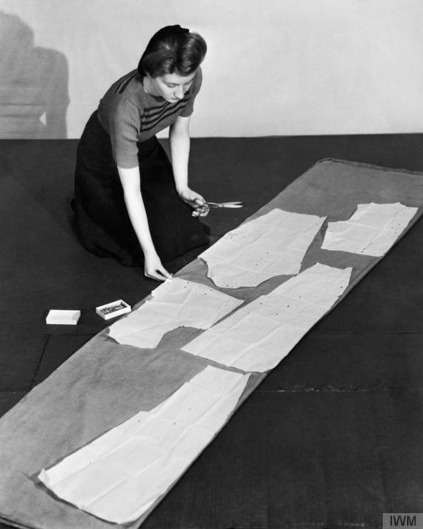 Cutting out a dress on the floor 1940s