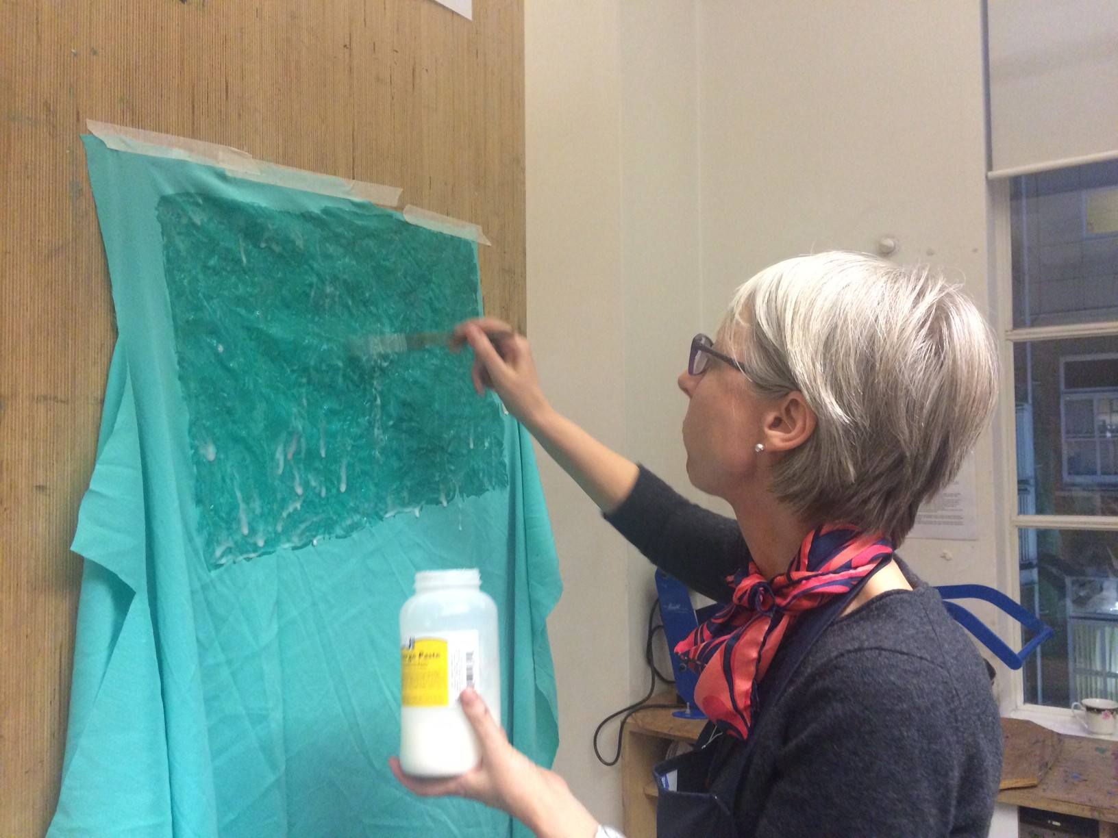 painting the silk with discharge paste