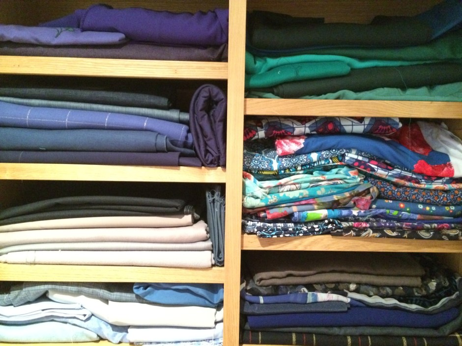Fabric carefully arranged on shelves