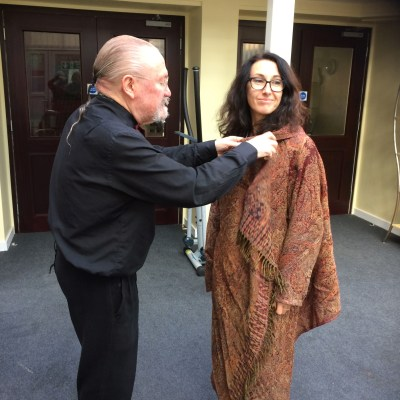 Eion dressing Marianna in the Indian wool scarf jacket