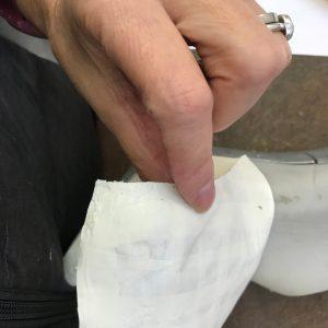 Carefully removing masking tape
